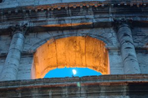 The  Moon through an arch in the Coliseum